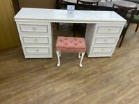 Beautiful white dresser with six drawers and pink stool