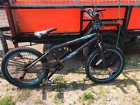 Set of 2 BMX bikes a Muddy Fox Atom and a Free Style BMX