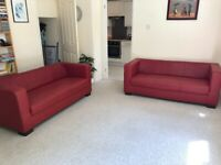 faux leather pair of sofas