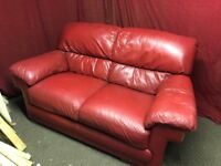 RED LEATHER 2 SEATER SOFA,CAN DELIVER