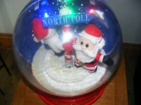 LARGE SNOWGLOBE WHICH PLAYS CAROLS AND LIGHTS UP