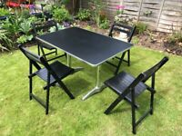 Vintage bistro table and four folding wooden chairs