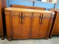 Large wooden drinks cabinet with drawers