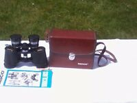 BINOCULARS by TASCO: 7X-15X35 plus leather style CARRYING CASE and information leaflet.
