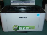 Samsung Laser Printer with two brand new black toner cartridges. Installation disc and all cables