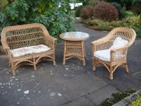 Wicker settee, chair and glass-topped table
