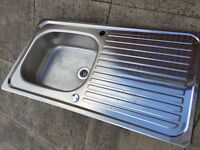 Stainless steel kitchen sink can be left of right drainer.
