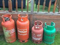 Selection of empty gas bottles - varying in size.