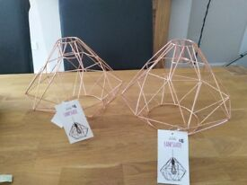 Two copper effect wire lamp shades, never been used.