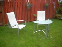 2 CHAIRS ALLOY & HALF GLASS TOP TABLE . can deliver locally .