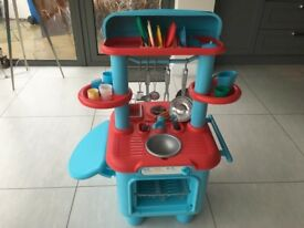 Toy kitchen for sale, with some accessories (plates, cups etc)