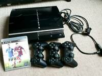 Playstation 3 with 3 wireless controllers and a game