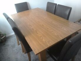 Wooden table & 6 leather look chairs