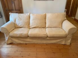 2 x 3 seater cream sofas - local delivery available