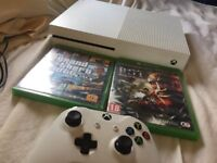 An xbox one a in great condition coming with two games attack on Titan and gta 5