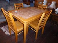 A beautiful solid wood table and chairs. 20/11