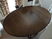 Solid Oak Dining Table -Drop Leaf Extendable with Table Protector and Striped Table Cloth