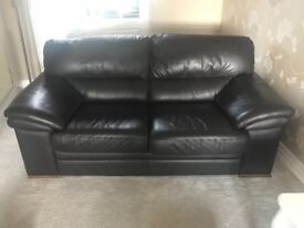 2 & 3 seater brown leather sofa and footstool all in excellent condition.