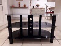 Black tempered glass TV stand.
