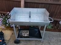 Open drum barbeque