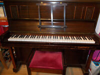 Holman piano in good conditon. Regularly tuned. With piano stool.