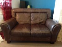 Two brown DFS leather sofas