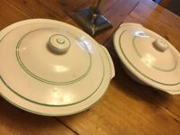 Two cream and green serving dishes