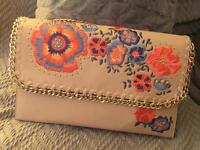Floral cream clutch bag