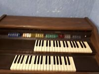 Lowrey L65 model organ. Very good condition. This debut is self-contained with 2 37-note keyboards.