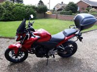 CB500F motorcycle with panniers, heated grips, top box and screen