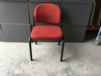 Red fabric with black metal framework visitor chair