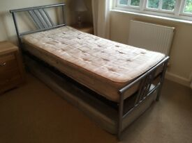 Silver grey framed metal single bed with mattesss