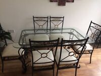 Glass and cast iron dining table and 6 chairs