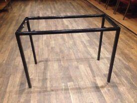 Tube framed table bases