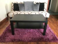Sofa bed with cover + cushions + carpet + coffee table.