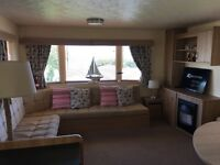 Caravan to let 8 Berth on a beautiful Haven site New Quay Quey West West Wales