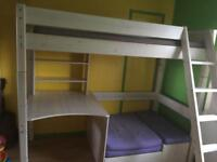 Loft bed with desk, shelves, single futton bed and storage space