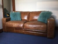 Large tan leather sofa bed