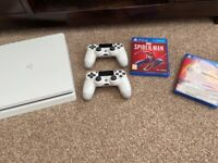 PS4 Slim 500gb Hardly Used. 2 controllers 2 Games