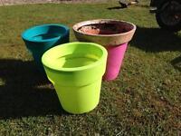 3 bright coloured garden plant pots planters