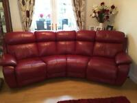 Red leather couch and chair and poofie