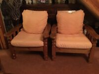 Two solid pine lounge or conservatory chairs
