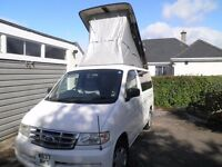 Ford Freda camper van White with electric roof, year 2000 2 litre petrol Automatic
