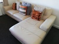 4 seater Left hand corner leather sofa and foot stool