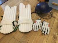 Junior kookaburra cricket pads, kookaburra bat, gloves and helmet