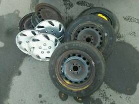 4 spokes steel rims ,2 tyres and spare wheel