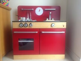 Wooden Toy kitchen in very good condition.