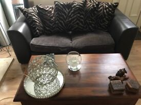 2 seater DFS sofa real leather with zebra print scatter cushions