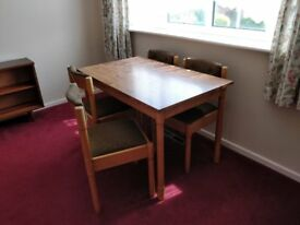 Wooden dining table plus four chairs