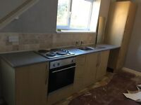 kitchen units, sink and cooker